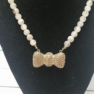 Cookie Lee bow rose gold necklace